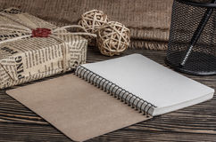 Notebook pen and a box of old books on a  table Royalty Free Stock Images