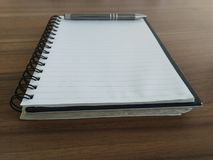 Notebook with a pen. Business notebook and pen Stock Photos