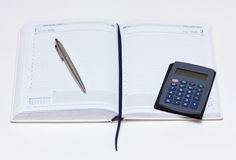 Notebook, pen, calculator. Personal organizer, pen and calculator on white background Royalty Free Stock Image