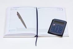 Notebook, pen, calculator Royalty Free Stock Image