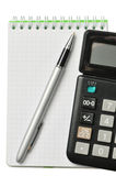 Notebook, pen and calculator. On a white background Royalty Free Stock Photos