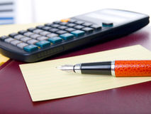Notebook, pen and calculator Royalty Free Stock Photography