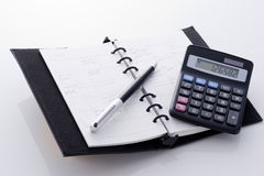 Notebook , pen and calculator Royalty Free Stock Image