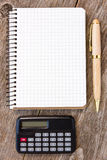 Notebook, pen and calculator Stock Photo