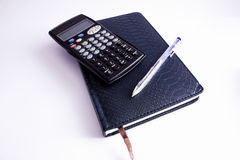 Notebook pen and calculator Royalty Free Stock Image