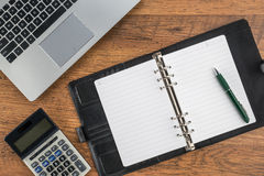 Notebook and pen with calculator on the desk Stock Photography