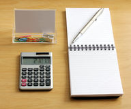 Notebook pen calculator paper clips sharpener Stock Images