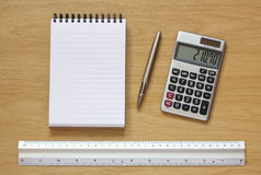 Notebook pen calculator and ruler on desk Royalty Free Stock Photo