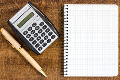 Notebook with  pen  and calculator Stock Image
