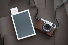 Notebook with pen and camera on white background Top view. Free space for design stock image