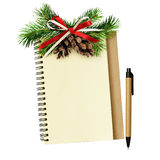 Notebook and pen with Christmas decorations Royalty Free Stock Photo