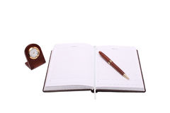 Notebook pen and clock Stock Photography