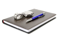 Notebook, pen and clock Royalty Free Stock Photo