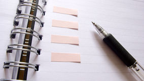 Notebook and pen closeup stock photography