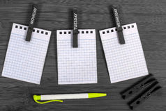 Notebook, pen and clothespins Stock Photography