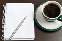 Notebook, Pen & Coffee Stock Images