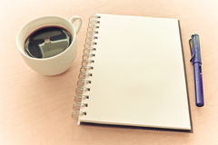 Notebook pen and coffee Royalty Free Stock Images