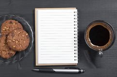 Notebook, pen, coffee and cookies Royalty Free Stock Images