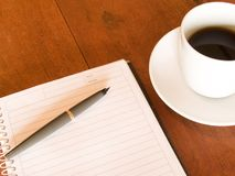 Notebook, pen and coffee cup Stock Images
