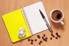 Notebook, pen and coffee cup Royalty Free Stock Photos