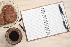 Notebook with pen and coffee Stock Photos