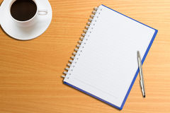 Notebook, pen, coffee on the table Royalty Free Stock Image
