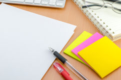 Notebook with pen and color note paper Royalty Free Stock Photography
