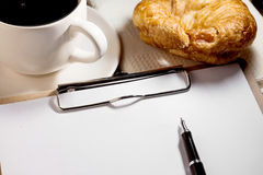 Notebook,pen,cup of coffee and  croissant Royalty Free Stock Photos