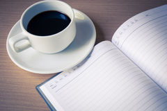 Notebook pen and cup of coffee Stock Photography