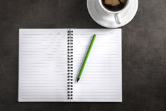 Notebook with pen and cup of coffee Stock Photography