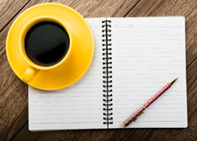 Notebook pen and cup of coffee Royalty Free Stock Image
