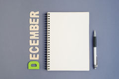 Notebook with pen and December month wording Stock Images
