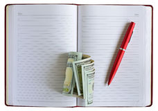 Notebook pen dollars Royalty Free Stock Image
