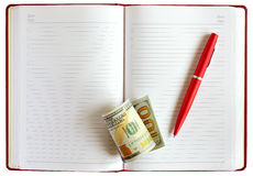 Notebook pen dollars Stock Photography