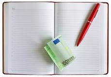 Notebook pen dollars. Money euro cash. notebook and pen Stock Photos