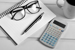 Notebook pen eyeglasses and calculator Stock Photo