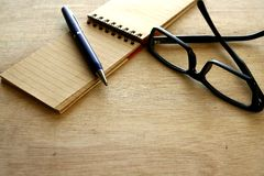 Notebook, pen and eyeglasses Royalty Free Stock Photo