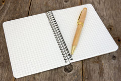 Notebook with a pen on the floor Stock Image