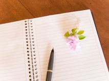 Notebook, pen, and flower Royalty Free Stock Photography