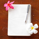 Notebook with pen and flower Stock Images