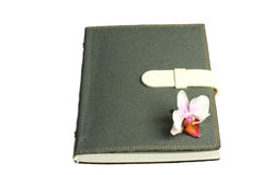 Notebook with pen and flower and orchid. The notebook it kept all the plan and the memory Stock Photo