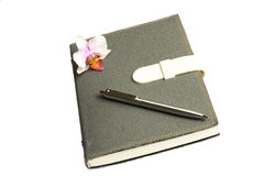Notebook with pen and flower and orchid. The notebook it kept all the plan and the memory Stock Photos