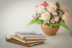 Notebook and pen with flowerpot Stock Photo
