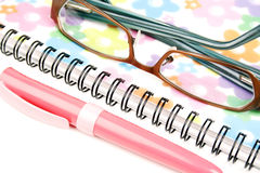 Notebook, pen and glasses Royalty Free Stock Image