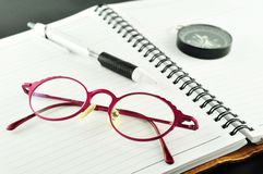 Notebook with pen and glasses Stock Image