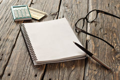 Notebook with pen, glasses, calculator with gold credit card Stock Photography