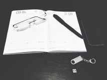Notebook, pen, glasses. Flash drive on the office table Stock Image