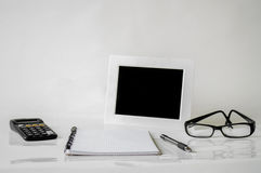 Notebook, pen, glasses and frame Royalty Free Stock Photo