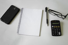 Notebook, pen, glasses and frame Stock Photo