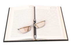 Notebook with pen and glasses Royalty Free Stock Photography